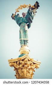 Statue of Independence and Liberty on marble pedestal in center of Kiev.
