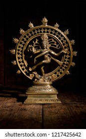 Statue of indian hindu god Shiva Nataraja - Lord of Dance on wooden background