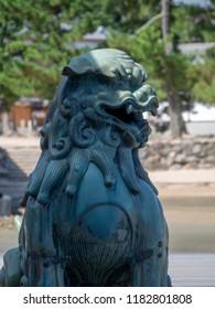 "Statue at Itsukushima Shrine, Japan. Itsukushima Shrine is a Shinto shrine on the island of Itsukushima (popularly known as Miyajima), best known for its ""floating"" torii gate."