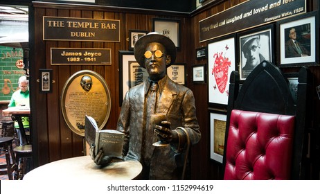 A statue of James Joyce sits in the temple bar in Dublin Ireland. Joyce was an Irish writer who wrote about and frequented irish pubs. June of 2018 Dublin Ireland, editorial descriptive