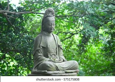 Statue of Japanese kannon, zazen style, JAPAN.