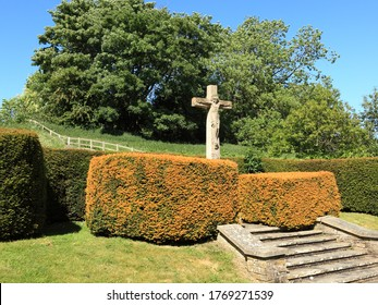 statue of Jesus Christ on the cross in a scenic English churchyard in summertime
