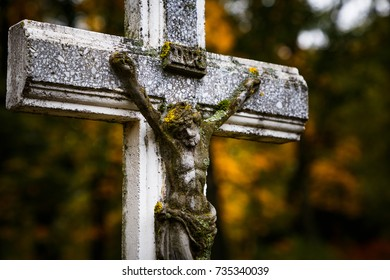 Statue of Jesus Christ. Jesus on cross. Moss and stone. Nailed hands of Jesus. Symbol of faith, hope and love.