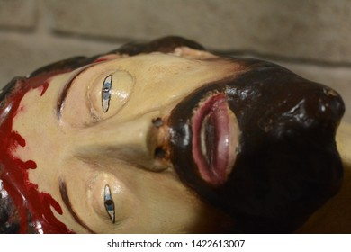 Statue of Jesus Christ with wounds on the body