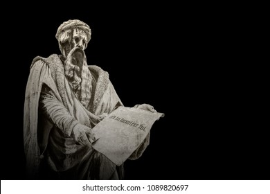 "Statue of Johannes Gutenberg isolated on a black background. ""Et la lumiere fut"" is the french sentence for the biblical ""Then there was light""."