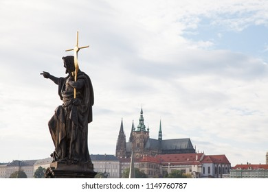 Statue of John the Baptist, Prague Castle in the background, Czech Republic