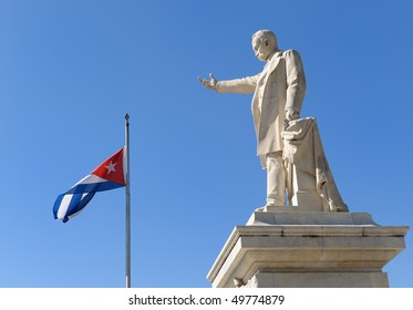Statue of Jose Marti, Cienfuegos and Cuban flag, Cuba