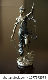 Statue of justice. Femida with the libra and the sword