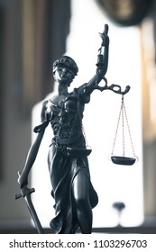 Statue of justice. Femida with the libra and the sword close up
