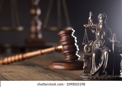 Statue of justice, gavel, vintage scales.