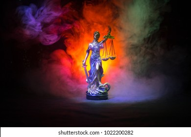 The Statue of Justice - lady justice or Iustitia / Justitia the Roman goddess of Justice on a dark fire background