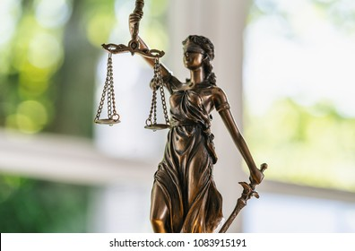 Statue of Justice - lady justice or Iustitia / Justitia the Roman goddess of Justice in a lawyer office