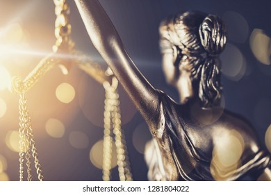 The Statue of Justice - lady justice or Iustitia / Justitia the Roman goddess of Justice - with bokeh