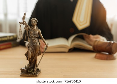 statue of justice on desk with legislature studying legal and legislation. concept of law, legal, legislation.
