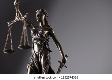 Statue of justice on gray background.