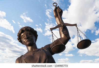 Statue of Justice on sky background
