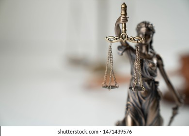 Statue of justice on white background.