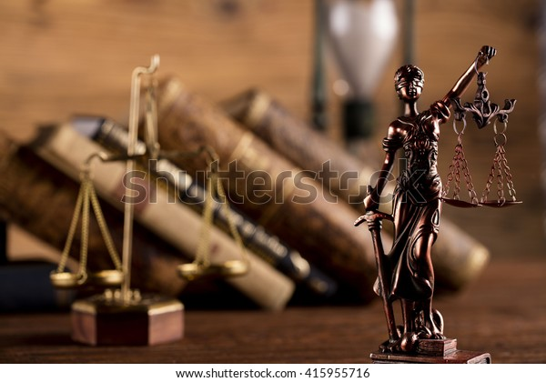 Statue of justice, scales of justice,books, hourglass, law theme