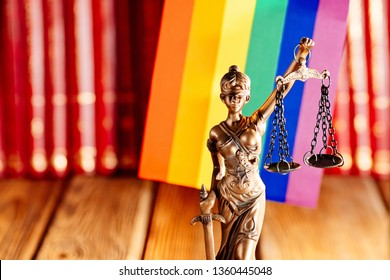Statue of Justice - symbol of law and justice with lgbt flag. Lgbt rights and law