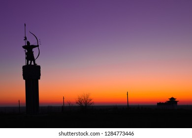 A statue of a Kalmyk shooter during sunset in Elista, Kalmykia, Russia