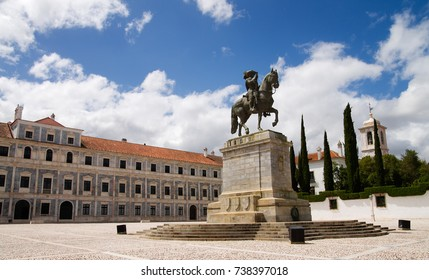 Statue of King John IV (D. Joao IV) on horseback in front of Ducal Palace and under a blue and white clouded sky. Vila Vicosa, Alentejo, Portugal