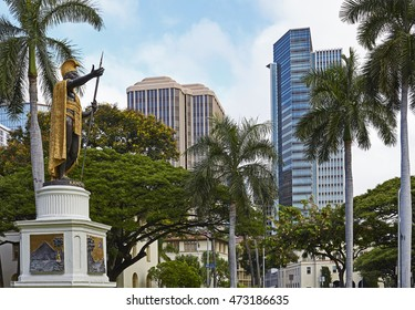 A statue of King Kamehameha fronts the business district of Honolulu. / Honolulu, Hawaii - August 6, 2016: King Kamehameha Statue in front of the old Judiciary Building in downtown Honolulu, Hawaii.