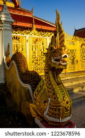 The statue of the king of Nagas in the path of the monoment looks terrible.