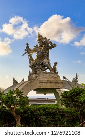 Statue of Kumbakarna, a demon in Hindu religion,stands against the Blue Sky in the Uluwatu Temple Complex, also famous for its Monkey Population, in Bali, Indonesia