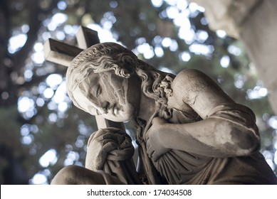 statue lady with cross