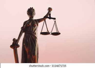 Statue of lady Justice or Justitia with scale on bright background