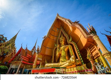 Statue of a large golden Buddha in a sitting position at Wat Tham Suea or Tham Suea temple, Kanchanaburi, Thailand