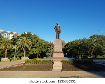 Statue of Lenin in Sochi central Park in Russia. Lenin monument with green trees and blue clear sky in the background