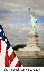 Statue of Liberty with American flag in the foreground