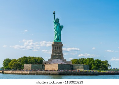 The statue of Liberty  with blue sky background.