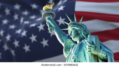 the statue of liberty with the blurry american flag waving in the background. Democracy and freedom concept