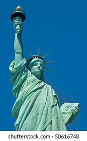 The Statue of Liberty detailed vertical photo, clear blue sky