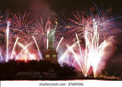 Statue of liberty with fireworks in the background