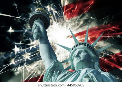 Statue of liberty with fireworks and flag of USA
