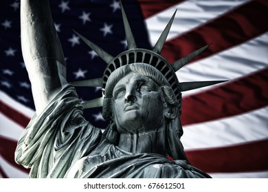 Statue of Liberty with flag of the United States of America.