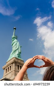 the Statue of Liberty and hand heart, I love you, freedom. America is the land of freedom