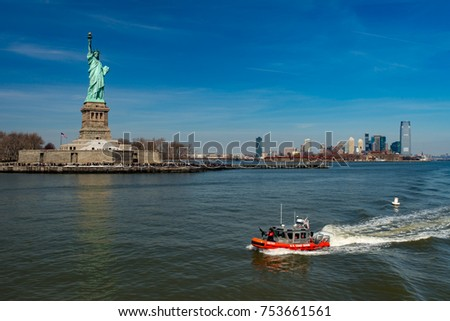 Statue of Liberty with machine gun's equipped boat on front, New York, USA