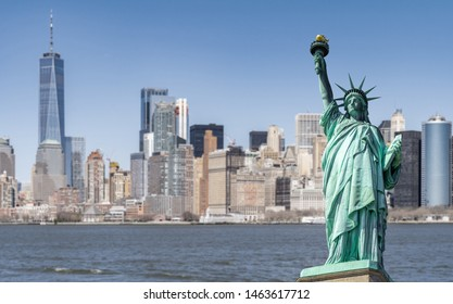 Statue of Liberty with Manhattan downtown  Skylines building in background, New York City , NYC USA.