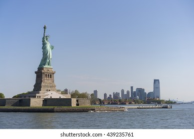 Statue of Liberty with New Jersey in background