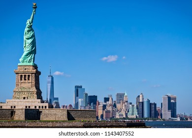 The Statue of Liberty with New York City in the background.