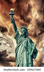 The Statue of Liberty in New York City. Front view on a beautiful sunny day.