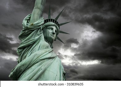 The Statue of Liberty in New York, a detail of the head with stormy clouds, USA