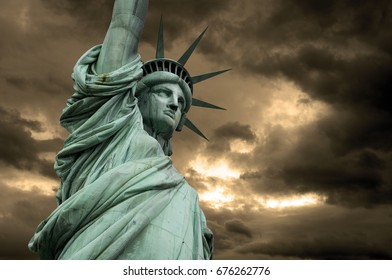 Statue of Liberty in New York, a detail of the head with stormy clouds, USA