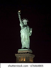 Statue of Liberty at night in New York Harbor USA.