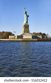 Statue of Liberty on pedestal under the river