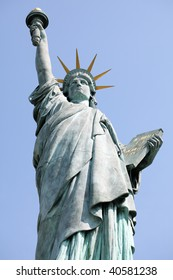 Statue of Liberty in Paris against a blue sky